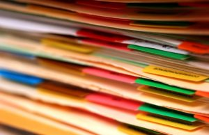 Close up shot of Medical records in a pile